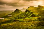 Scenic view of Quiraing mountains sunset with dramatic sky in Scottish highlands Isle of Skye United Kingdom poster