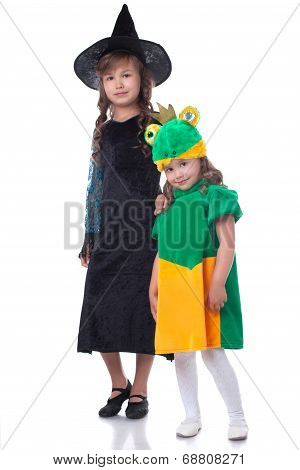 Two smiling sisters posing in carnival costumes