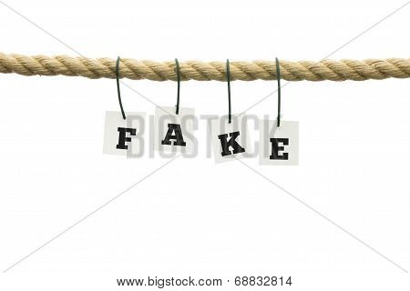 Word - Fake - Suspended From A Rope