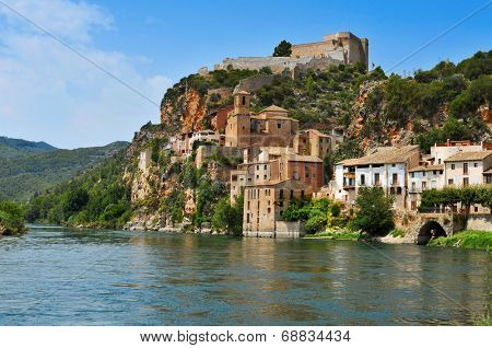 view of the Ebro River and the old town of Miravet, Spain, highlighting the Templar castle in the top of the hill