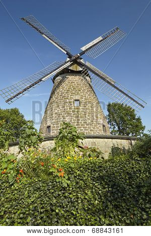 The windmill Hartum (Hille Germany) is a dutch type of windmill and is part of the Westphalia Mill Street (Westfaelische Muehlenstrasse). poster