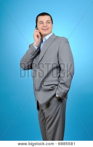 Handsome businessman talking with cell phone