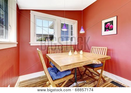 Bright Red Dining Area With Rustic Table Set