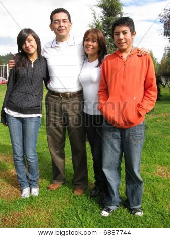 Family Stands On Grass
