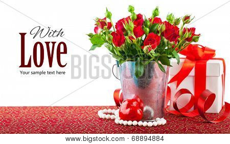 Bunch red roses with gift and heart. Isolated on white background
