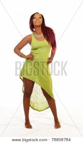 Young African American Woman Standing In Green Dress