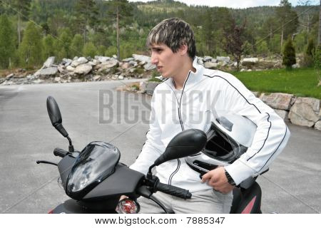 young man on motor scooter