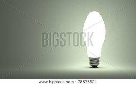 Shining Ellipsoidal Light Bulb On Gray