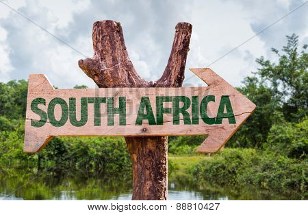 South Africa wooden sign with countryside background