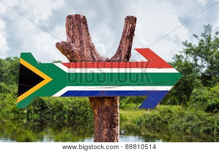 South Africa Flag wooden sign with countryside background