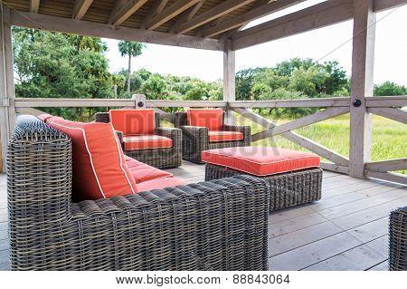 Brown Rattan Furniture With Orange Cushions