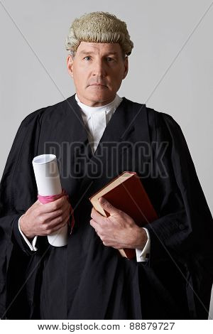 Portrait Of Male Lawyer Holding Brief And Book