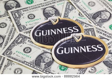 Beermats From Guinness Beer And Us Dollars.