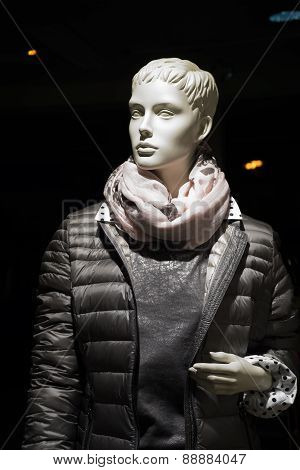 Female mannequin with anorak and scarf