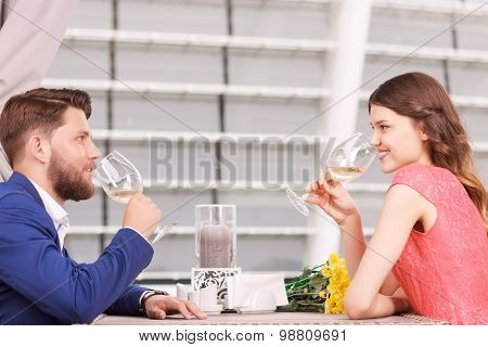 Nice couple drinking white wine in cafe