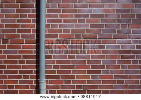 Outside Wall, Bricks And Downpipe