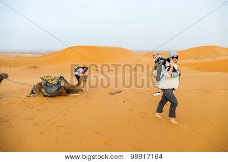 Dunes Erg Chebbi near Merzouga, Morocco - tourist during a camel tour into the erg