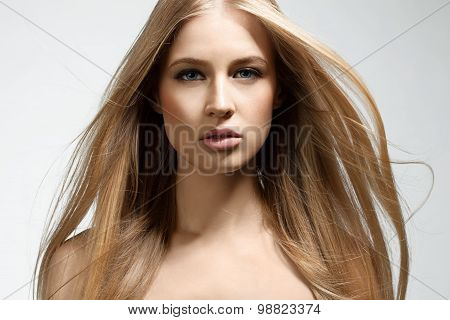 Portrait of a blonde girl with flowing hair