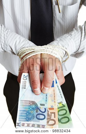 Businessman Has His Hands Tied Up Holding Money