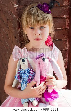 Girl With Homemade Toys