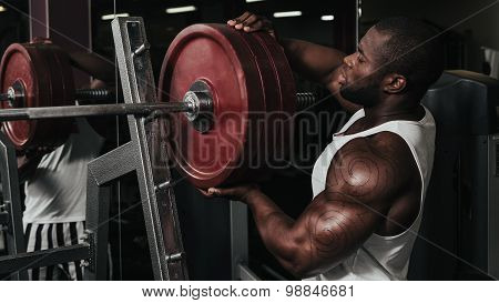 Weight training African doing bodybuilding