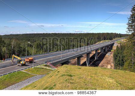 Steel Bridge Over The Forest Stream Under Construction.