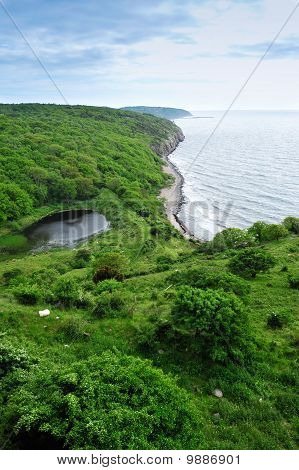 Bornholm islad green coastline with small lake, Denmark, Europe poster