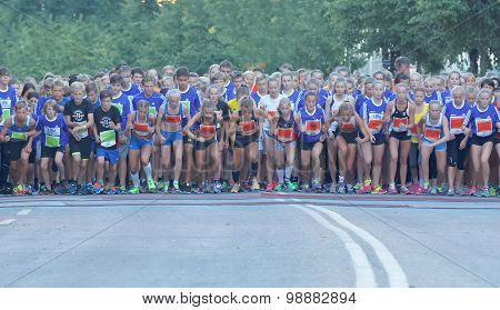 Large Group Of Running Girls And Boys On The Start Line