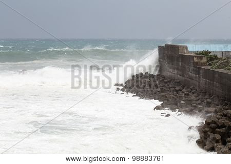 Stormy sea during Typhoon Souledor. waves crashing on barrier wall poster