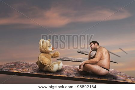 Strange man looks at toy bear