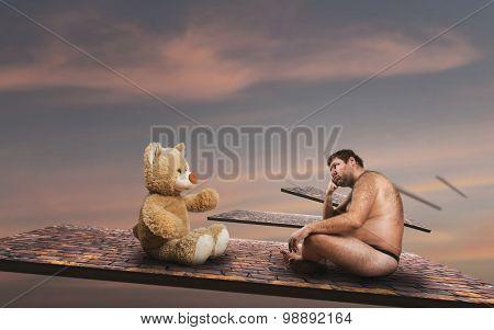 Strange man looks at toy bear