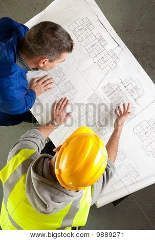 Builders Examine Blueprints