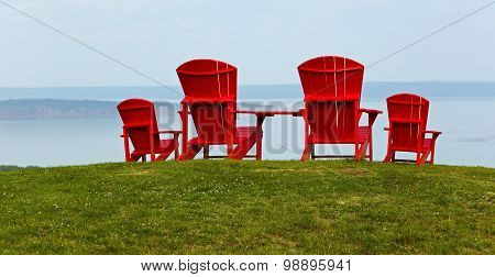 Four Red Adirondack Chairs