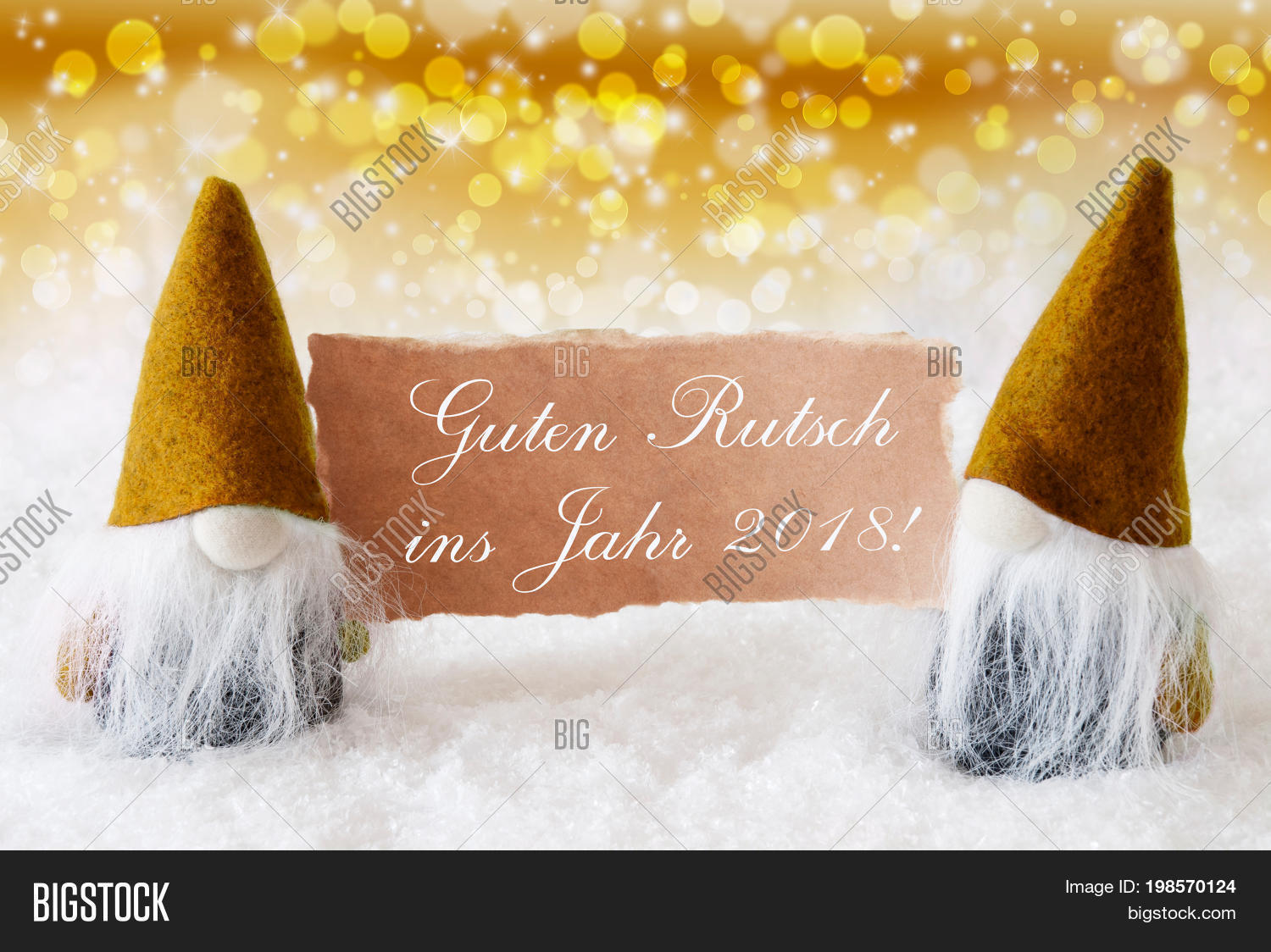 christmas greeting card with two golden gnomes sparkling bokeh and noble background with snow