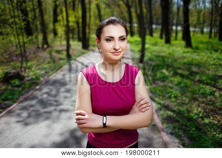 Young Pretty Fit Woman Respiting After Jogging In The Park