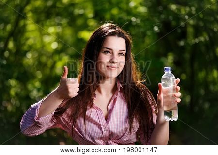 Happy Beautiful Young Smiling Woman Holding A Bottle Of Clean Wa