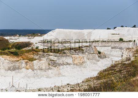 Chalk rocks in mining quarry. Industrial Mining Concept