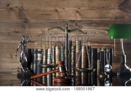Gavel, books, scales, Themis. Law concept. Place for text.