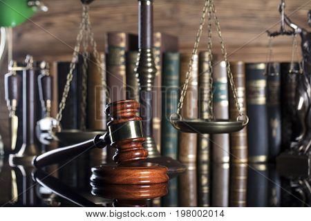 Law symbols. Lawyer theme. Judge wooden gavel. Place for typography.