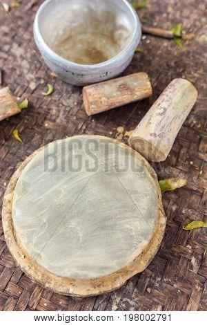 Thanaka wood and Kyauk pyin stone slab. Tanaka is Burmese tradition cosmetic made from bark of tanaka tree. poster