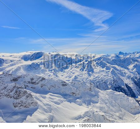 View from Mt. Titlis in Switzerland in wintertime. The Titlis is a mountain located on the border between the Swiss cantons of Obwalden and Bern, mainly accessed from the town of Engelberg on the northern side.