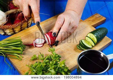 Woman Hands Cutting Fresh Crunchy Radish On Cutting Board With