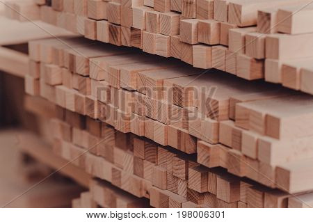 Bars Of Different Types Of Wood In The Carpentry Shop.