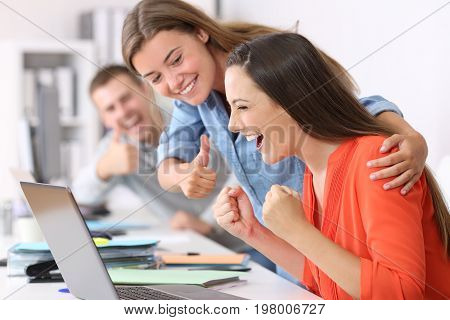 Employee Being Congratulated By Colleagues