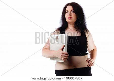 Portrait Of Young Overweight Attractive Woman With Scale In Hand