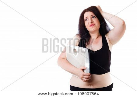 Young Overweight Woman In Despair Holding Scale In Hand