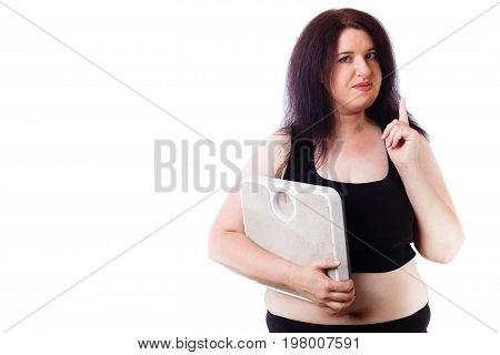 Portrait Of Young Overweight Attractive Woman With Pointing Gest
