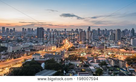 Bangkok City at sunrise time Hotel and resident area in the capital of Thailand.Top view : modern building in Business bangkok district at Bangkok city with skyline at twilightThailand