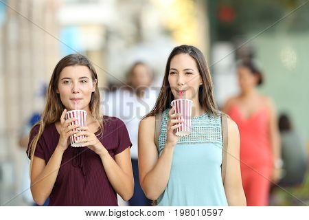Friends Drinking A Takeaway Refreshment