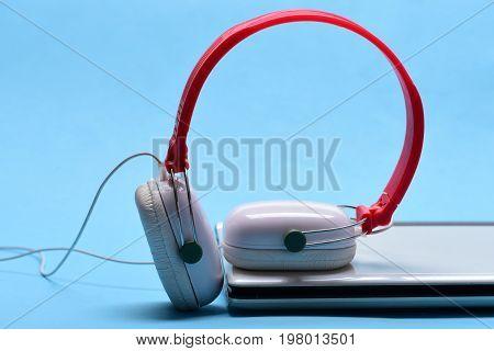 Sound Recording Idea. Digital Equipment Concept. Headphones And Silver Laptop